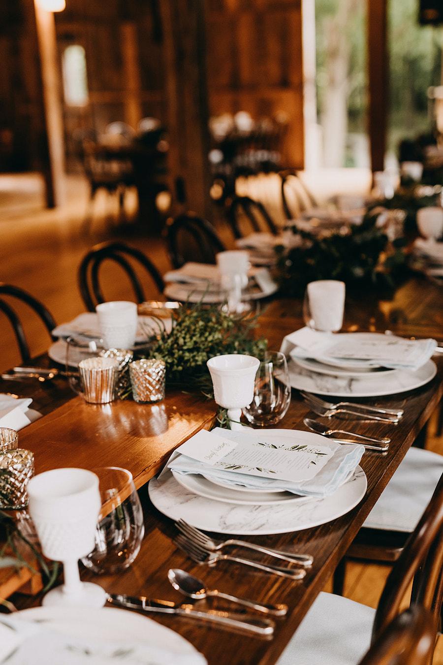 tabletop decor at barn wedding reception
