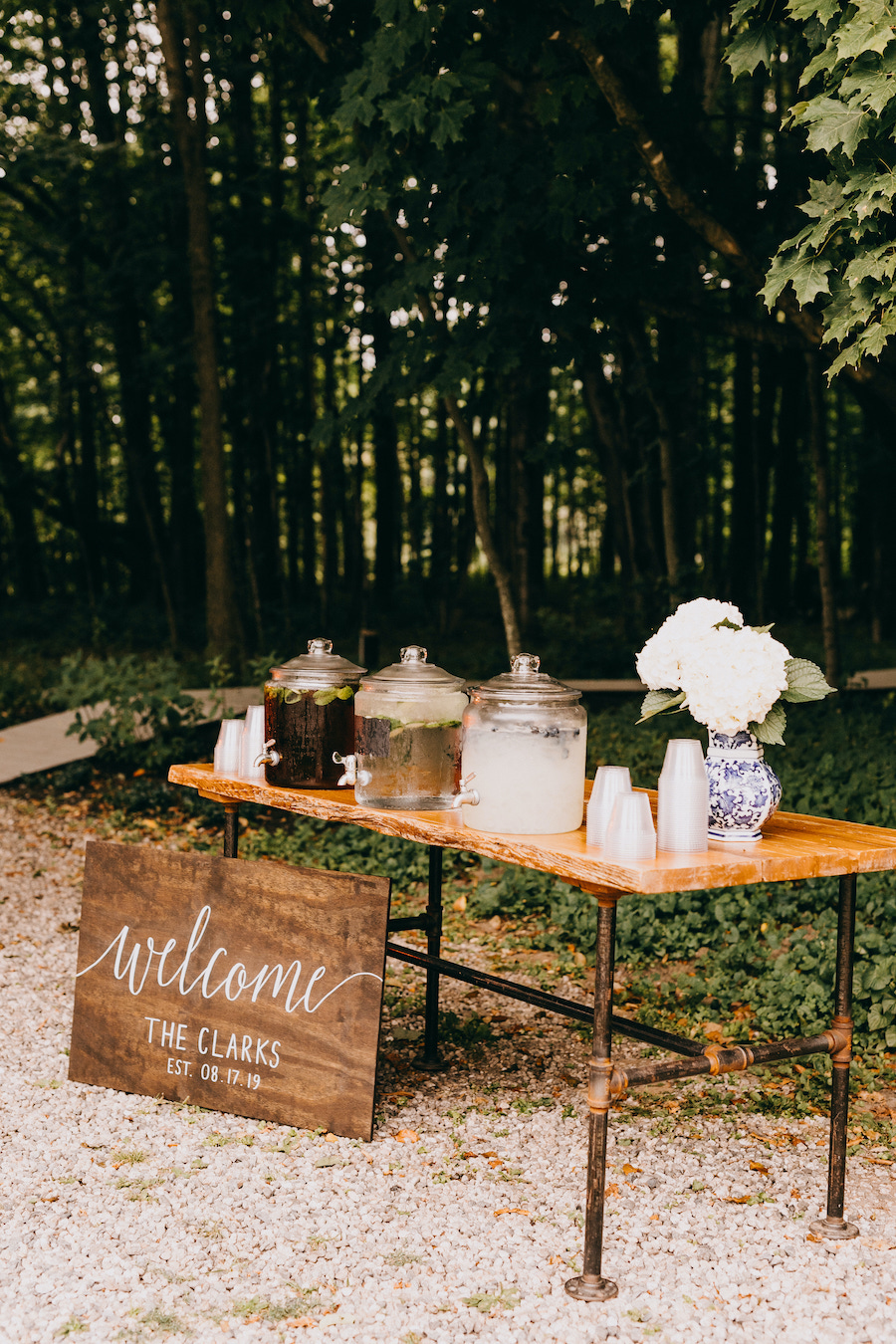 welcome sign at wedding ceremony at beverage bar