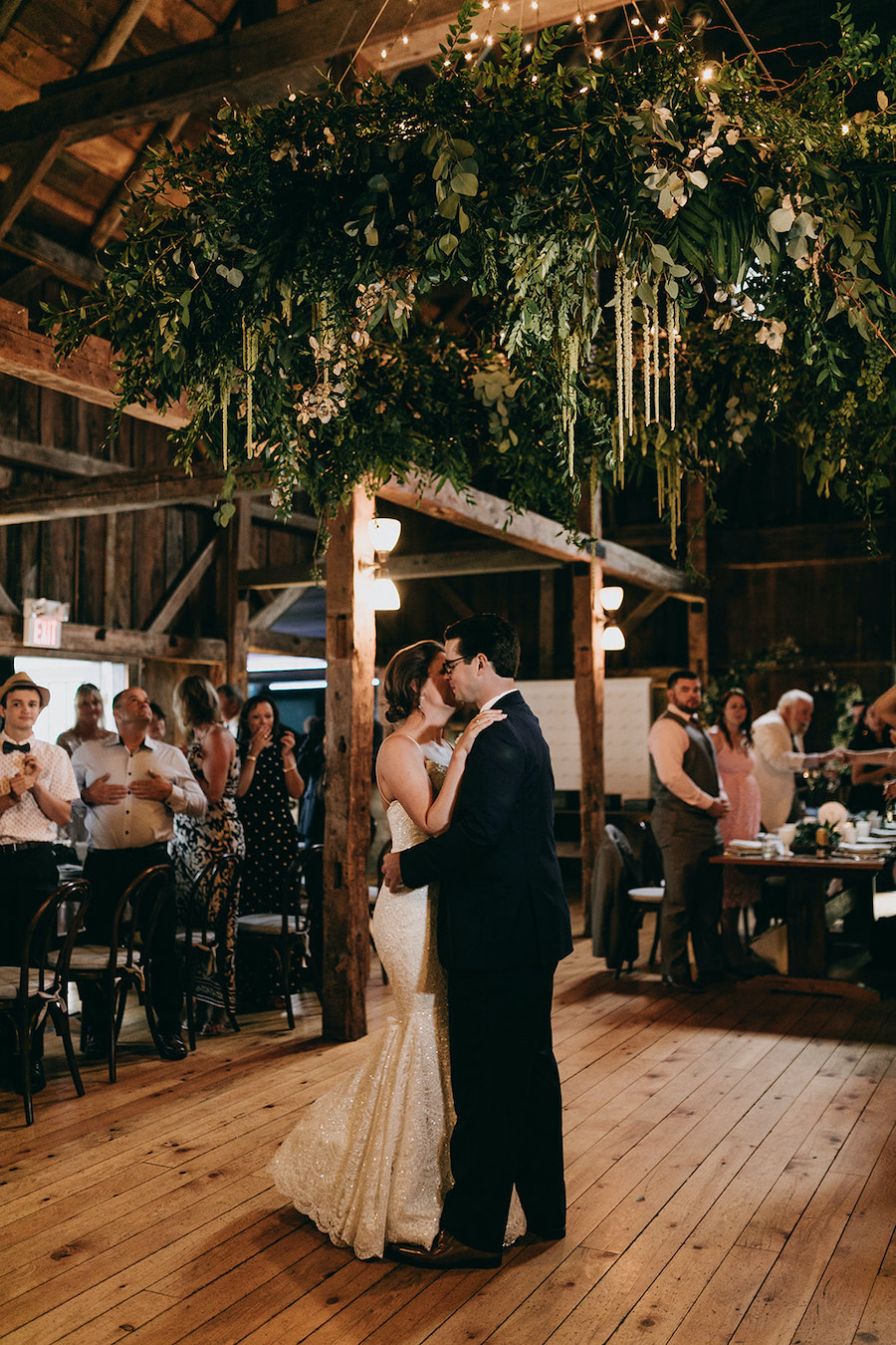 newlywed first dance under custom chandelier