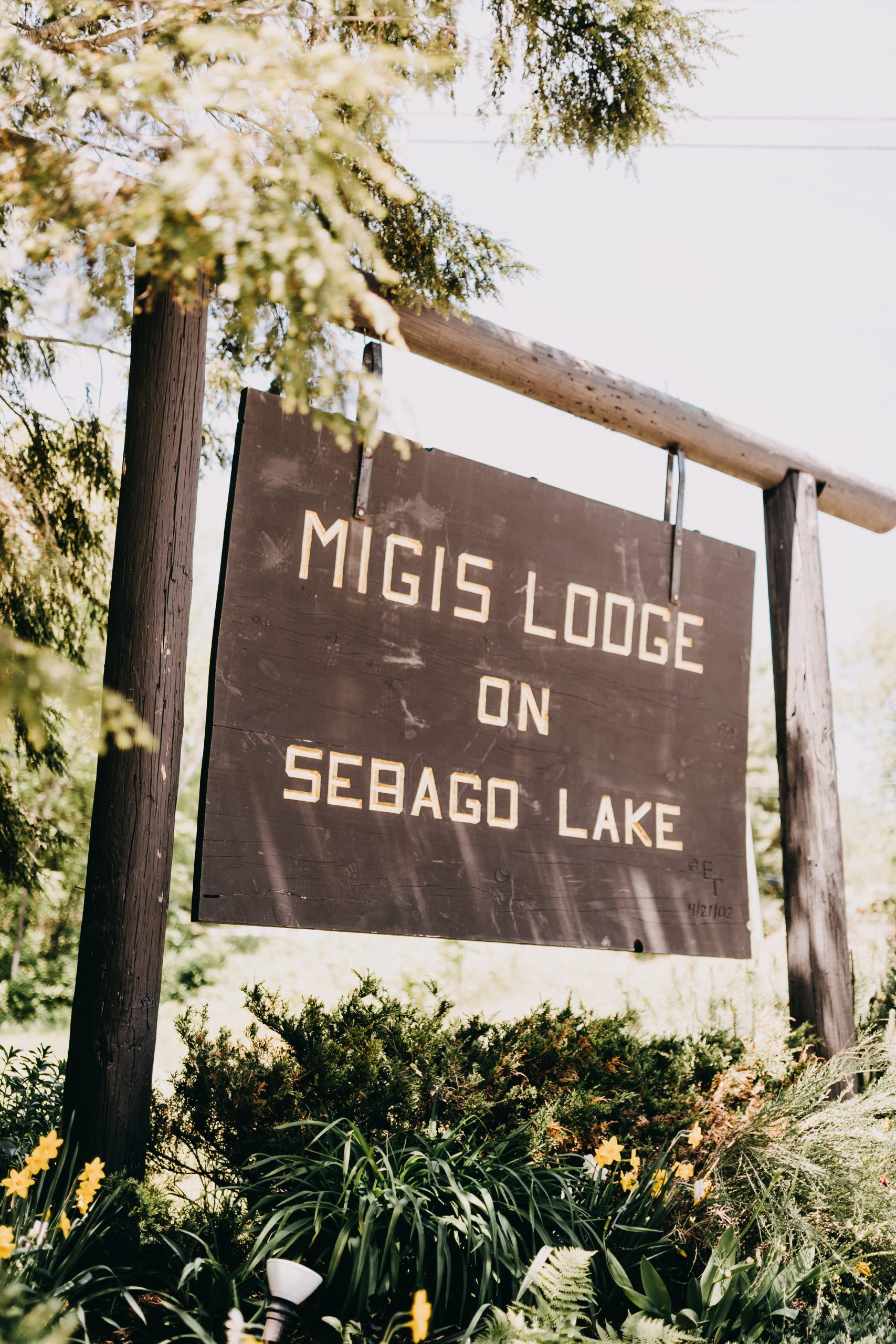 Sign displayed at Migis Lodge on Sebago Lake.