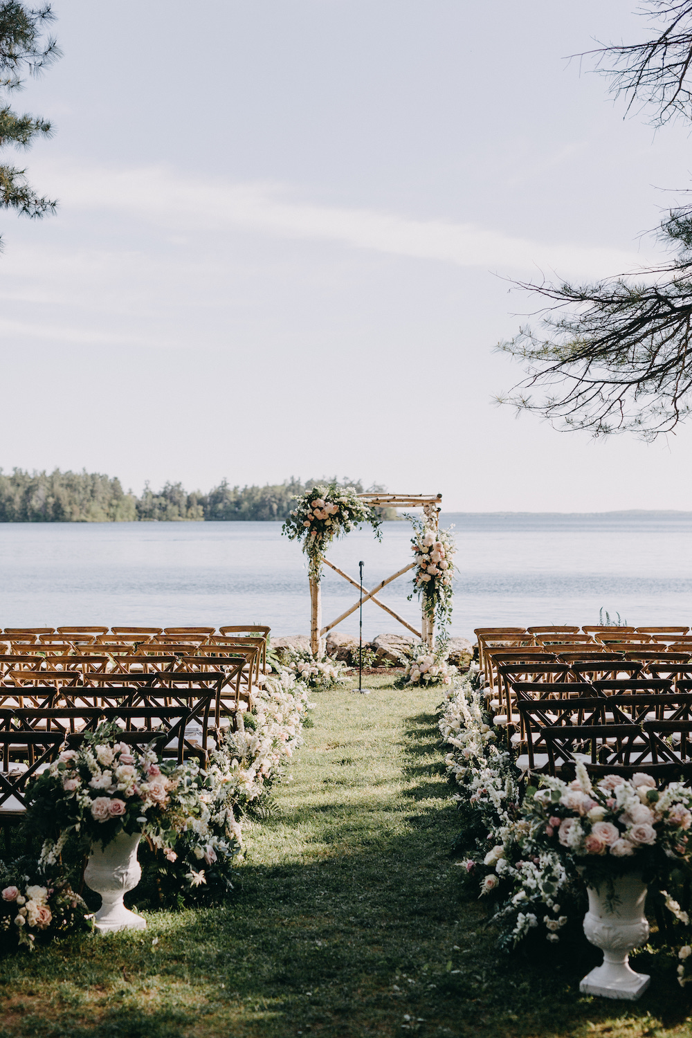 A blush and white elegant Lake Sebago wedding ceremony.
