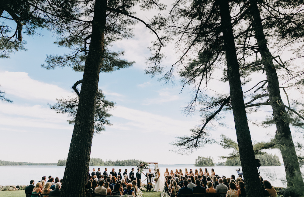 View of the wedding ceremony with Lake Sebago in the background.