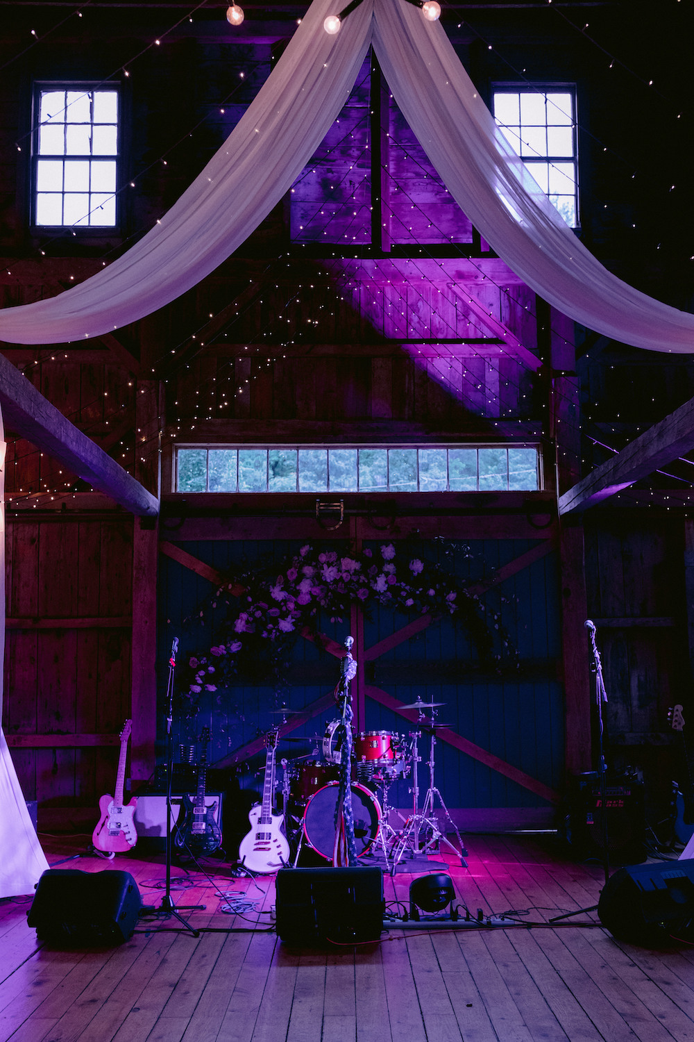 String lights illuminate a band's reception setup.