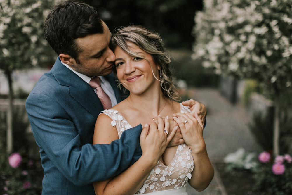 Bride and groom embrace on their wedding day