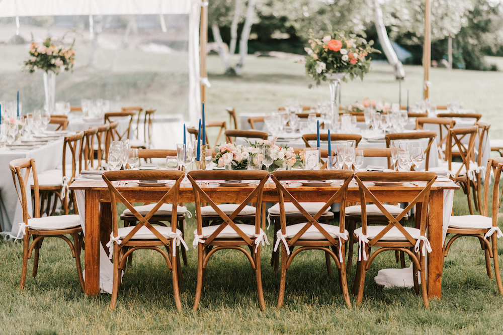 Wooden farm tables beautifully decorated for Casco Bay wedding reception