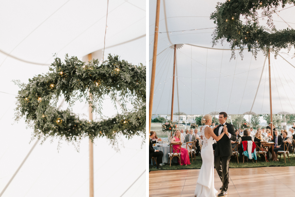Bride and groom dance beneath hanging greenery chandelier by Griffin Griffin Lighting
