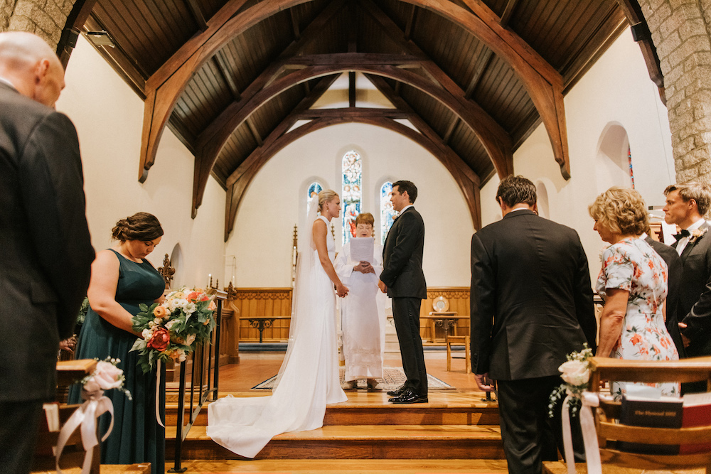 Bride and groom exchanging vows at the church altar