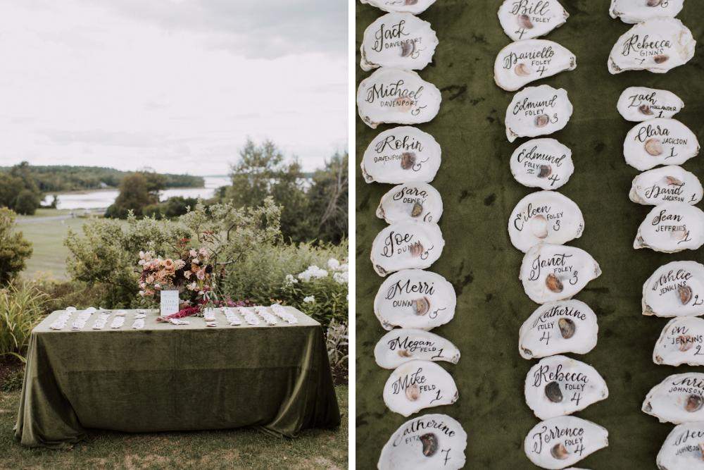 Escort card display atop a forest green velvet linen tabletop.