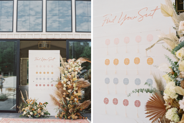 Seating chart display with pastel tones surrounded by golden and ivory florals.