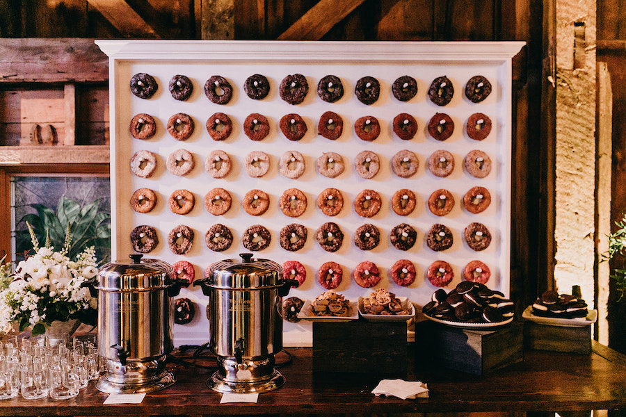 Coffee station with donut wall featuring colorful donut display.