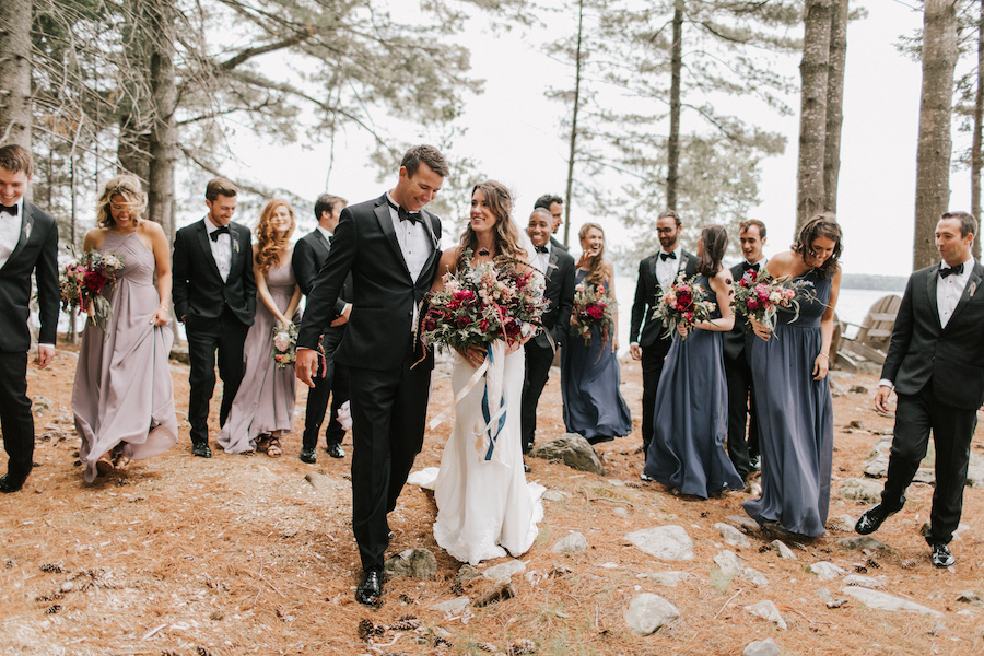 Bride and groom and wedding party in Maine forest scenery.