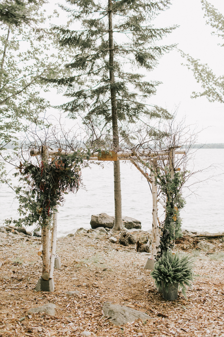 Wooden ceremony arbor for lakeside wedding.